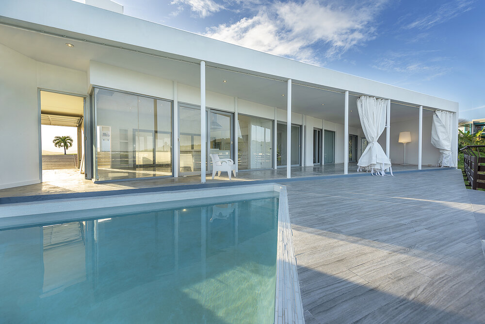 triangle_pool_open_curtains_Terrace_Casa_Flores_architecture_Puerto_rico_fuster_architects_house+Photo+by+Jaime+Navarro